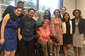 A group of diverse young Fellows with Judith Heumann